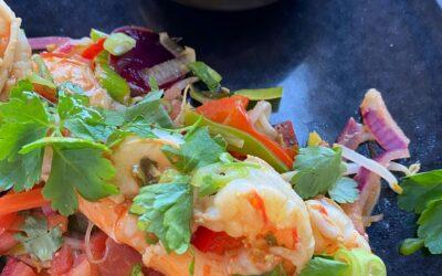 Gemarineerde scampi met groenten in een hartverwarmende gembersaus